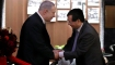 Netanyahu and a Chinese official shaking hands at the Shanghai Jewish Refugees Museum in Shanghai, China.